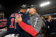 Rafael Devers #11 of the Boston Red Sox is congratulated by his manager Alex Cora #20 after their teams 5-1 win over the Los Angeles Dodgers in Game Five of the 2018 World Series at Dodger Stadium on October 28, 2018 in Los Angeles, California.