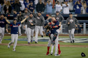 Christian Vazquez #7 and David Price #24 embrace Chris Sale #41 of the Boston Red Sox to celebrate their 5-1 win over the Los Angeles Dodgers in Game Five to win the 2018 World Series at Dodger Stadium on October 28, 2018 in Los Angeles, California.