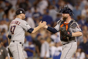 Brian McCann #16 celebrates with Chris Devenski #47 of the Houston Astros after defeating the Los Angeles Dodgers 7-6 in eleven innings to win game two of the 2017 World Series at Dodger Stadium on October 25, 2017 in Los Angeles, California.