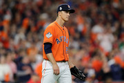 Zack Greinke #21 of the Houston Astros reacts against the Washington Nationals during the first inning in Game Seven of the 2019 World Series at Minute Maid Park on October 30, 2019 in Houston, Texas.
