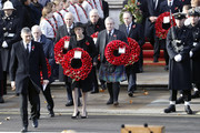 Leader of the Labour Party, Jeremy Corbyn (2ndL) Leader of the Liberal Democrats, Vince Cable, British Prime Minister, Theresa May (C) and Leader of the Scottish National Party Ian Blackford (6thL).hold wreaths during the annual Remembrance Sunday memorial on November 11, 2018 in London, England. The armistice ending the First World War between the Allies and Germany was signed at Compiègne, France on eleventh hour of the eleventh day of the eleventh month - 11am on the 11th November 1918. This day is commemorated as Remembrance Day with special attention being paid for this year's centenary.