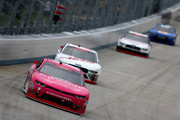 Elliott Sadler, driver of the #1 OneMain Financial Chevrolet, leads a pack of cars during the NASCAR Xfinity Series Bar Harbor 200 presented by Sea Watch International at Dover International Speedway on October 6, 2018 in Dover, Delaware.