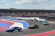 Elliott Sadler, driver of the #1 OneMain Financial Chevrolet, leads a pack cars during the NASCAR XFINITY Series Drive for the Cure 200 at Charlotte Motor Speedway on September 29, 2018 in Charlotte, North Carolina.