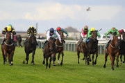 Paul Hanagan riding Free Zone (R, green) win The Dan Hague Yarmouth No. 1 Bookmaker Handicap Stakes at Yarmouth racecourse on September 18, 2013 in Yarmouth, England.