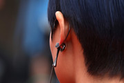 """Singer Li Yuchun, earring detail, attends the screening of """"Yomeddine"""" during the 71st annual Cannes Film Festival at Palais des Festivals on May 9, 2018 in Cannes, France."""