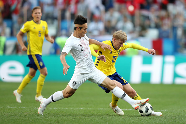 Sweden Vs. Korea Republic: Group F - 2018 FIFA World Cup Russia [player,sports,soccer player,sports equipment,football player,soccer,team sport,football,sport venue,ball game,yong lee,emil forsberg,sweden,russia,korea republic,nizhniy novgorod stadium,group,korea republic: group f - 2018 fifa world cup,match]