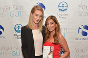 """Rosie Huntington-Whiteley (L) and author Dr. Nigma Talib attend the """"Younger Skin Starts In The Gut"""" book launch party at Four Seasons Hotel Los Angeles at Beverly Hills on March 22, 2016 in Los Angeles, California."""