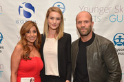"(L-R) Author Dr. Nigma Talib, Rosie Huntington-Whiteley and Jason Statham attend the ""Younger Skin Starts In The Gut"" book launch party at Four Seasons Hotel Los Angeles at Beverly Hills on March 22, 2016 in Los Angeles, California."