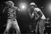 Image has been converted to black and white.) Gwen Stefani (L) and Pharrell Williams perform onstage during iHeartRadio Jingle Ball 2014, hosted by Z100 New York and presented by Goldfish Puffs at Madison Square Garden on December 12, 2014 in New York City.