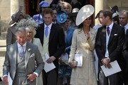 (L to R) Prince Charles, Prince of Wales, Camilla, Duchess of Cornwall, Prince Harry, Princess Beatrice, Catherine, Duchess of Cambridge, Prince William, Duke of Cambridge and Prince Andrew leave the church after the Royal wedding of Zara Phillips and Mike Tindall at Canongate Kirk on July 30, 2011 in Edinburgh, Scotland. The Queen's granddaughter Zara Phillips will marry England rugby player Mike Tindall today at Canongate Kirk. Many royals are expected to attend including the Duke and Duchess of Cambridge.