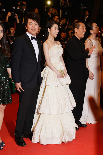 'Coming Home' Premieres at Cannes [red carpet,carpet,dress,gown,flooring,event,premiere,formal wear,fashion,strapless dress,gui lai,zhang yimou,zhang huiwen,coming home premieres,l-r,cannes,france,premiere,cannes film festival]