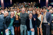 """Paul Wernick, Rosario Dawson, Ruben Fleischer, Rhett Reese, Jesse Eisenberg, Zoey Deutch and Avan Jogia pose with fans at a """"Zombieland 2"""" Panel and Surprise Screening at Los Angeles Convention Center on October 12, 2019 in Los Angeles, California."""