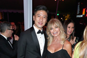 CFO at AMTD Philip Yau (L) and actor Goldie Hawn attend the amfAR Gala Los Angeles 2017 at Ron Burkle's Green Acres Estate on October 13, 2017 in Beverly Hills, California.