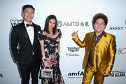 (L-R) CFO at AMTD Group Philip Yau, guest and artist Romero Britto attend the amfAR Gala Los Angeles 2017 at Ron Burkle's Green Acres Estate on October 13, 2017 in Beverly Hills, California.