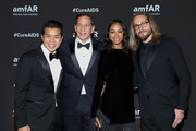 Actress Zoe Saldana and Marco Perego (R) pose during the red carpet of the amfAR gala dinner at the house of collector and museum patron Eugenio López on February 5, 2019 in Mexico City, Mexico.