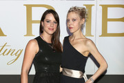 Antonia Campbell-Hughes (L)and  Michelle Ryan(R) attend the amfAR Milano 2014 - Cocktail as part of Milan Fashion Week Womenswear Spring/Summer 2015 on September 20, 2014 in Milan, Italy.