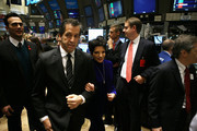 L-R)  amfAR Ambassador Cheyenne Jackson, amfAR Chairman Kenneth Cole and amfAR ambassador Liza Minnelli walk the trading floor before ringing the opening bell at the New York Stock Exchange in recognition of December 1st's World AIDS Day on November 30, 2010 in New York City.