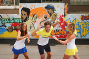 Monica Puig of Puerto Rico, Feliciano Lopez of Spain and Elina Svitolina of Ukraine pose after painting street art with Melbourne graffiti artist Daniel Wenn (unseen) during the ellesse Tennis Performance Apparel Launch on January 17, 2014 in Melbourne, Australia. The new range of tennis performance apparel will be worn by Feliciano Lopez, Elina Svitolina and Monica Puig at the Australian Open.