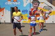 Feliciano Lopez of Spain, Elina Svitolina of Ukraine and Monica Puig of Puerto Rico prepare to paint street art with Melbourne graffiti artist Daniel Wenn (unseen) during the ellesse Tennis Performance Apparel Launch on January 17, 2014 in Melbourne, Australia. The new range of tennis performance apparel will be worn by Feliciano Lopez, Elina Svitolina and Monica Puig at the Australian Open.