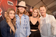 Musicians Brian Kelley (2nd L) and Tyler Hubbard (R) of Florida Georgia Line with Brittney Marie Cole (L) and Hayley Stommel (2nd R) attend the 2017 iHeartRadio Music Awards which broadcast live on Turner's TBS, TNT, and truTV at The Forum on March 5, 2017 in Inglewood, California.