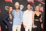 Musicians Brian Kelley (2nd L) and Tyler Hubbard (2nd R) of Florida Georgia Line with Brittney Marie Cole (L) and Hayley Stommel (R) attend the 2017 iHeartRadio Music Awards which broadcast live on Turner's TBS, TNT, and truTV at The Forum on March 5, 2017 in Inglewood, California.
