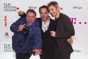 Director Philipp Kadelbach and actors Jan Josef Liefers and Armin Rohde attend the premiere for the film 'So viel Zeit' at Filmpalast Cologne on October 9, 2018 in Cologne, Germany.