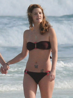 With her slim body and Light brown hairtype without bra (cup size 34C) on the beach in bikini