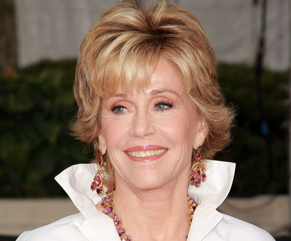 Jane Fonda 's short shag hairstyle perfectly frames her face. Jane