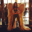 Alessandra Ambrosio tries on her wings.