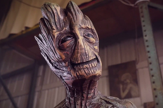 Watch a chainsaw artist carve groot sculpture out of