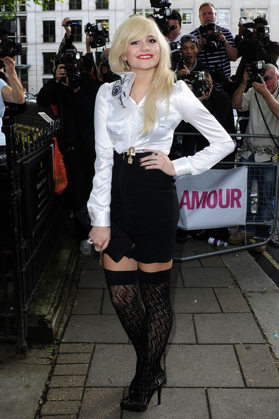 Pixie Lott poses for photographs as she arrives at the 2010 Glamour Awards held at Berkeley Square in London.