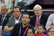 Mayor of London Boris Johnson and Arnold Schwarzenegger seen watching the USA vs Spain Men's Basketball Olympic Finals during the London 2012 Summer Olympics Games.