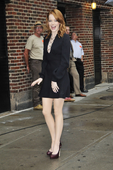 "Actress Emma Stone is seen walking outside the ""David Letterman"" show in New York.  Stone famous for her role in the movie ""Zombieland"" smiles and poses for photographers and fans."