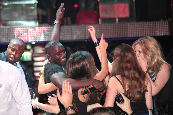 Akon American rapper Akon still has what it takes to impress the ladies as he preforms at the VIP Room in Paris.