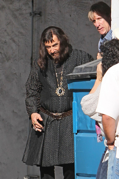 "Al Pacino - looking unrecognizable in his padded medieval costume - takes a break after filming a scene for ""Jack & Jill"" in LA. The actor is seen donning a long hair wig and a thick Tudor-style costume, complete with rings and chained boots."