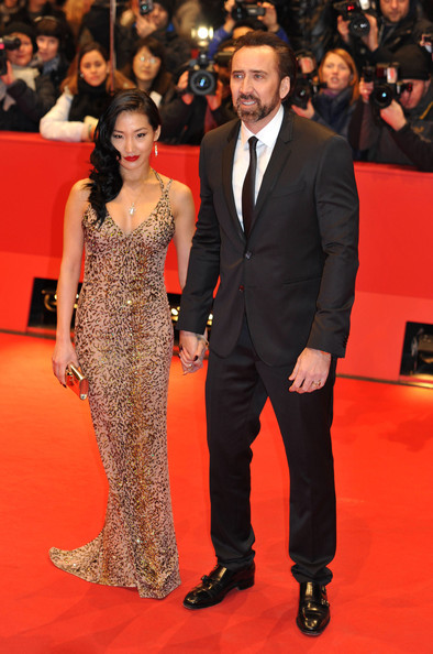 Nicolas Cage, his wife Alice Kim and Emma Stone walk the red carpet for the premiere of 'The Croods' at the 63rd Berlinale International Film.