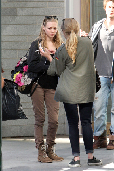 "Amanda Seyfried Amanda Seyfried talks with a couple of friends while out and about in Vancouver. Seyfried is appearing in the lead role of the upcoming fairy tale adaptation ""Red Riding Hood"", directed by ""Twilight"" director Catherine Hardwicke."