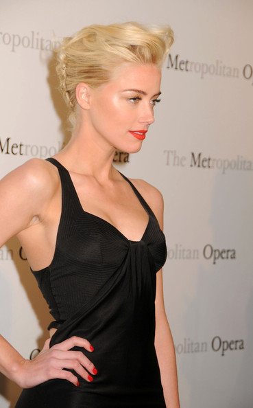Amber Heard Amber Heard wears a sexy black dress at the Metropolitan Opera ...