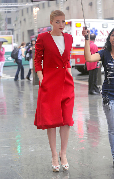 "Amber Heard braves the rain as she heads to the set of her upcoming film ""Syrup"" under the cover of an umbrella. Heard, star of the recent ""Drive Angry 3D"", wore a long red coat before changing into a gold tank top and long white skirt."