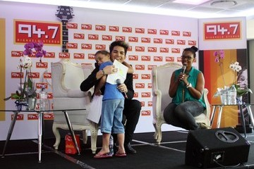 Johannesburg American singer-songwriter Adam Lambert seen meeting a 6 year old fan and receiving a gift while at a press conference at Radio station 94.7 Highveld Stere in Sandton, Johannesburg