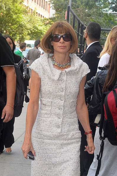 Anna Wintour, looking classy in a white dress and brown heels, makes her way to a New York Fashion Week event in New York City