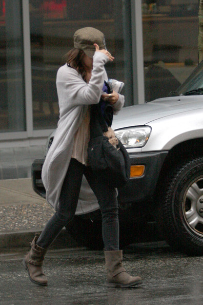 "Ashley Tisdale Ashley Tisdale tries to keep a low profile as she goes to lunch with a mystery male at an Italian Kitchen in Vancouver. The ""Hellcats"" star tried to protect her dog from the rain by carrying it in her purse."