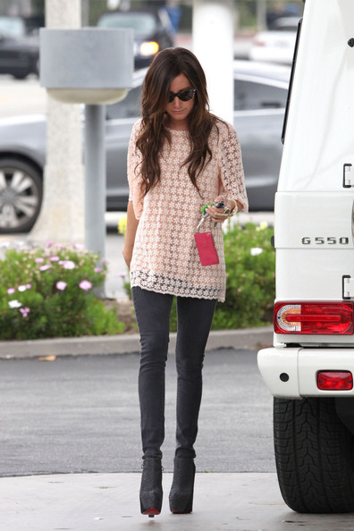 "Ashley Tisdale, wearing a baggy top, skinny black jeans and high heels, fills up the tank of her Mercedes SUV before heading to a business meeting in Hollywood. Tisdale's newest TV show ""Hellcats"" was recently canceled after only one season on the air."