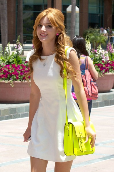 "A dressed up Bella Thorne and her ""Shake It Up"" co-star Zendaya are seen arriving at Kiss FM radio station in Los Angeles. The Disney stars looked to be embracing summer as they arrived in short dresses and colorful high heels."