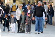 """**CUTE FAMILY ALERT** Brad Pitt's parents, William and Jane, go for an outing with grandkids Shiloh, Pax, Maddox, and Zahara in Venice, Italy. Maddox and Shiloh take turns jumping around, with Shiloh looking adorable in her striped sailor outfit (complete with white jeans!) while the equally fashionable Zahara is seen holding onto a Hello Kitty clutch that looks a little too large for her tiny frame! Pax holds onto grandpa William's hand as the family enjoys a nice day in Venice, with mother Angelina Jolie filming scenes for """"The Tourist."""