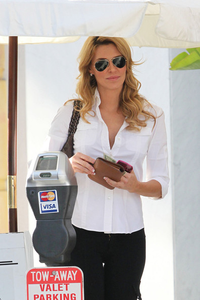 "Brandi Glanville Brandi Glanville of ""The Real Housewives of Beverly Hills"" is spotted picking up her car from valet in Los Angeles.  Brandi, sports a white top and black tight pants as she waits for her car."