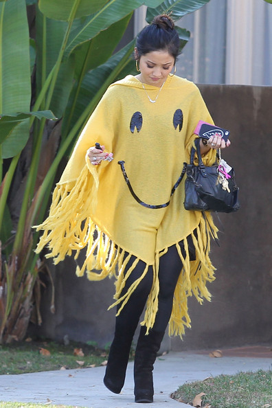 http://www1.pictures.zimbio.com/pc/Brenda+Song+covers+up+yellow+smiley+face+poncho+h6GtcBeX6kql.jpg