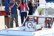 """Courteney Cox, Brian Van Holt, Busy Philipps, Ian Gomez, and the rest of the """"Cougar Town"""" cast celebrate a boat being launched successfully during a scene."""