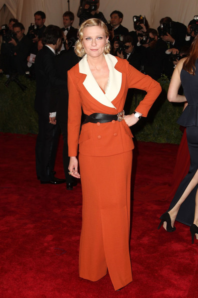 Kirsten Dunst walks the red carpet at the Met Gala at the Metropolitan Museum of Art in NYC.