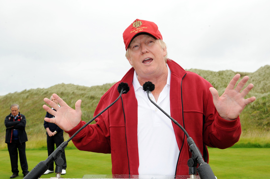 ... Donald Trump takes to the course at the Trump International Golf Links